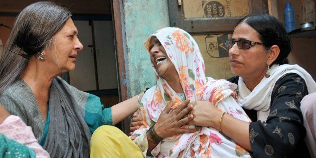 Polit Bureau member Brinda Karat consoling Zaira (C), mother of Junaid who was lynched by a mob while...