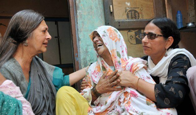 CPI(M) Polit Bureau member Brinda Karat consoling Zaira (C), mother of Junaid who was lynched by a mob...