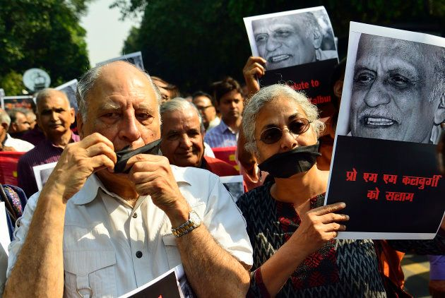 Writers and cultural activists on a silent protest march from Shree Ram Centre to Sahitya Akademi to...