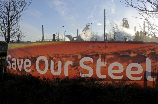 A sign is seen in front of the Tata steelworks in the town of Port Talbot, Wales, Britain March 30, 2016....