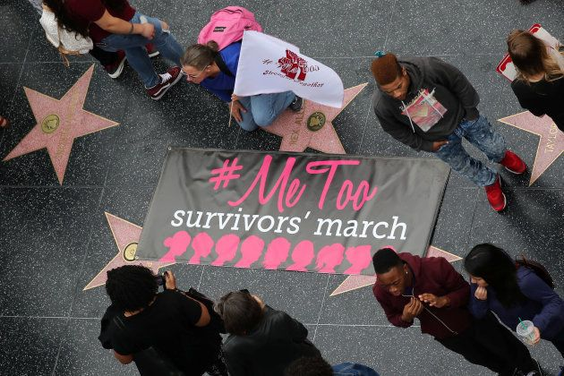 Women take part in a #MeToo protest march for survivors of sexual assault and their supporters in Hollywood...