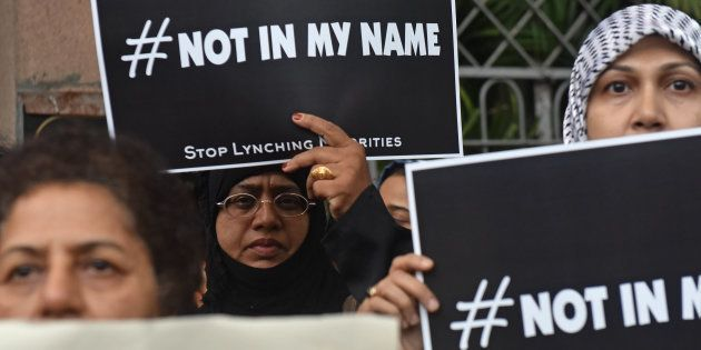 People participate in support of the campaign 'Not In My Name' against lynching of a Muslim teenager...