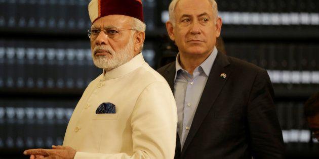 Indian Prime Minister Narendra Modi accompanied by Israeli Prime Minister Benjamin Netanyahu (R) during...