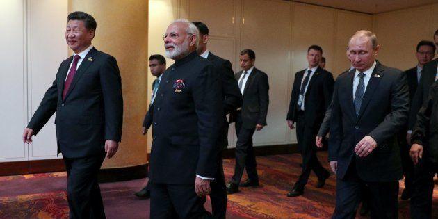 HAMBURG, GERMANY - JULY 07: President of China Xi Jinping (L), Prime Minister of India Narendra Modi...