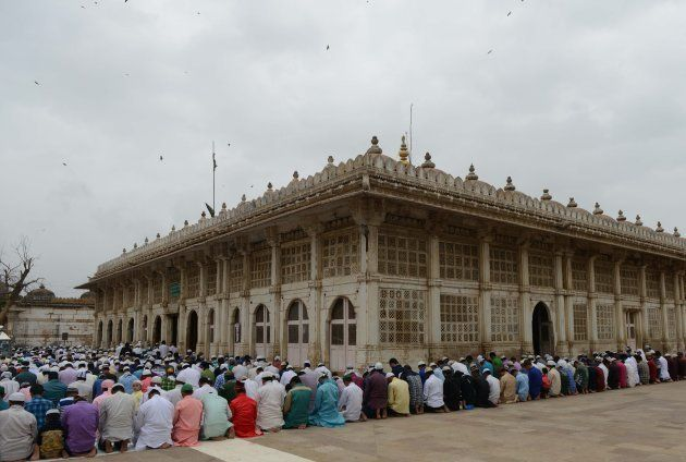 Muslims offer Eid al-Fitr prayers at the ancient Sarkhej Roza and masjid in Ahmedabad on July 7,