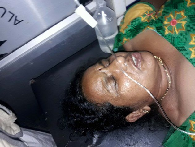 An injured woman being treated in a hospital after militants opened fire on the Amarnath Yatra in which...