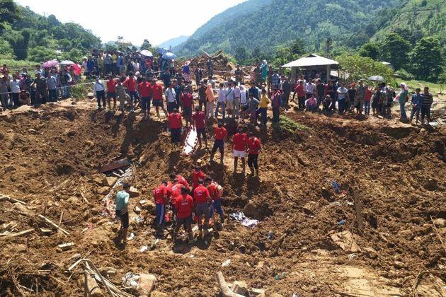 Indian National Disaster Response Force personnel take part in a rescue operation at the site of a landslide...