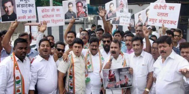 Congress party workers hold placards against Bollywood director Madhur Bhandarkar to protest against...