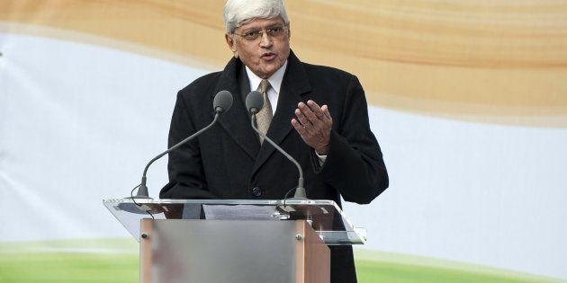 Gandhi's grandson, Shri Gopalkrishna Gandhi delivers a speech during a ceremony unveiling a statue of...