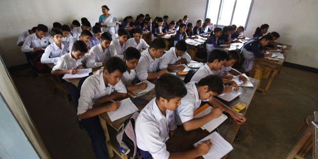 In this photograph taken on June 1, 2016, Indian schoolchildren and teachers take part in lessons in...
