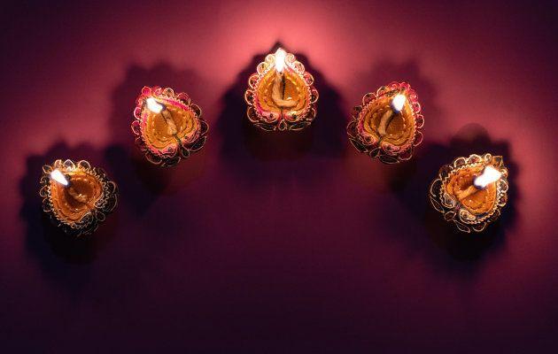 Happy Diwali - Clay Diya lamps lit during Dipavali, Hindu festival of lights