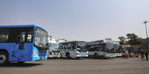 A range of newly-launched Tata Motors Ltd. hybrid and electric buses stand on display at the company's...