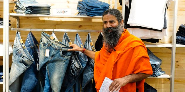 NEW DELHI,INDIA-NOVEMBER 05: Baba Ramdev during the opening of his clothing showroom Patanjali Paridhan at Netaji Subhash Place, in New Delhi. (Photo by Hardik Chhabra/India Today Group/Getty Images)