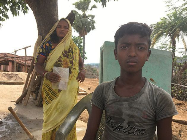 A child with his guardian at Munda tola in Rajabar. His father, a widower, works in the city. He and...