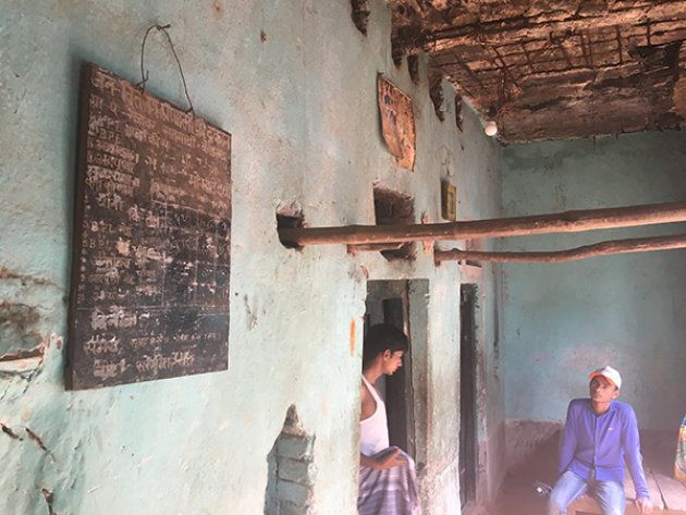 A PDS shop in Rajabar, Koderma District. PDS shops seldom have all information displayed outside, as...