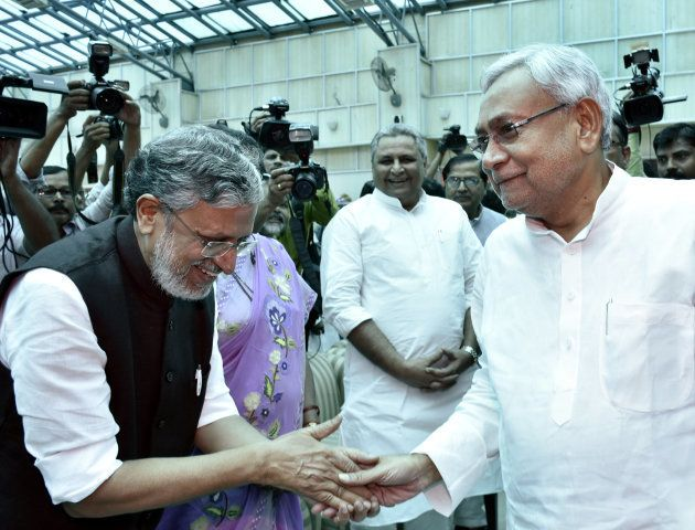 Bihar Chief Minister Nitish Kumar greets BJP leader Sushil Modi before oath taking ceremony at Raj Bhawan...