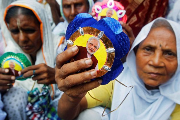 Widows, who have been abandoned by their families, show rakhis with a picture of Indian Prime Minister...