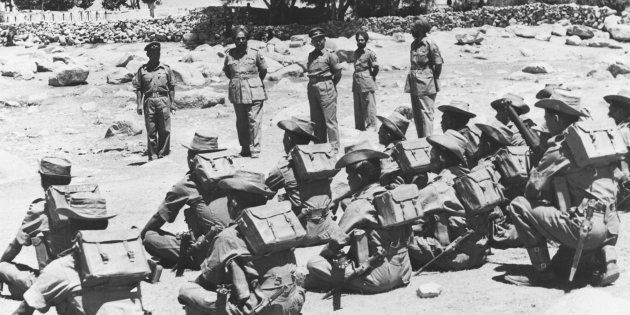 Indian troops being inspected before leaving their posts in the Ladakh border region during the war between...