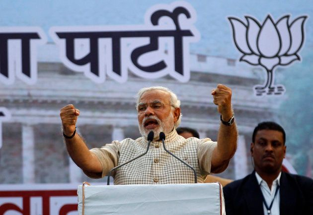 Narendra Modi, then prime ministerial candidate for Bharatiya Janata Party (BJP), gestures as he addresses...
