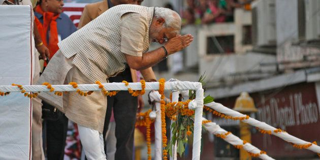 Narendra Modi greets his supporters after addressing a public meeting in Vadodara, May 16,