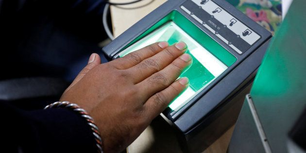 A woman goes through the process of finger scanning for the Aadhaar, at a registration centre in New