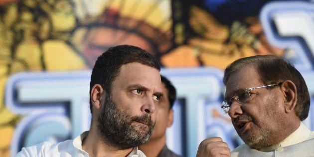 Congress Vice President Rahul Gandhi with Sharad Yadav during 'Sajhi Birasat Bachao Sammelan' called...