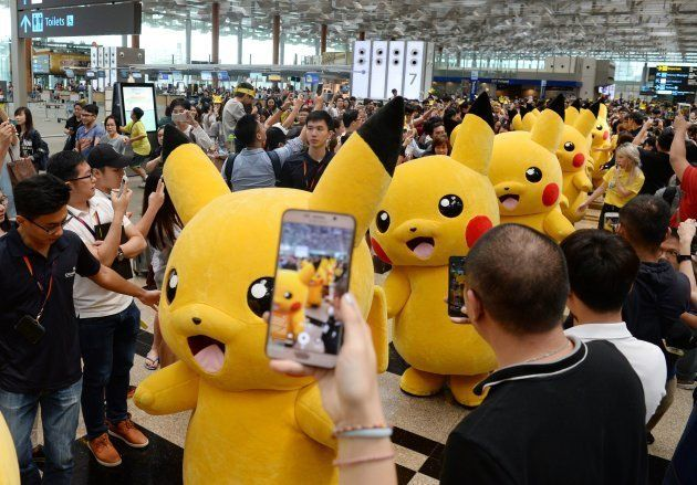 Fans gather to watch a Pikachu