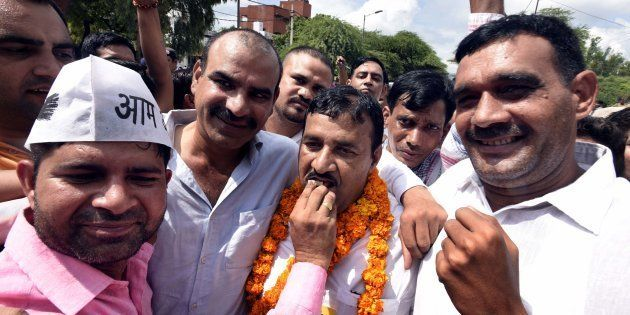 Ram Chandra, AAP candidate (center) along with his supporters after winning Bawana assembly by-poll,...