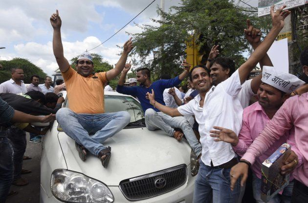 AAP Supporter celebrating after Ram Chandra, AAP candidate won Bawana assembly by-poll, at Delhi CM Residence...