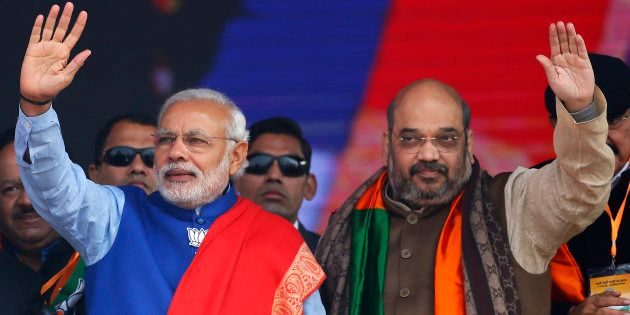 File photo of Indian Prime Minister Narendra Modi (L) and Amit Shah, the president of India's ruling...