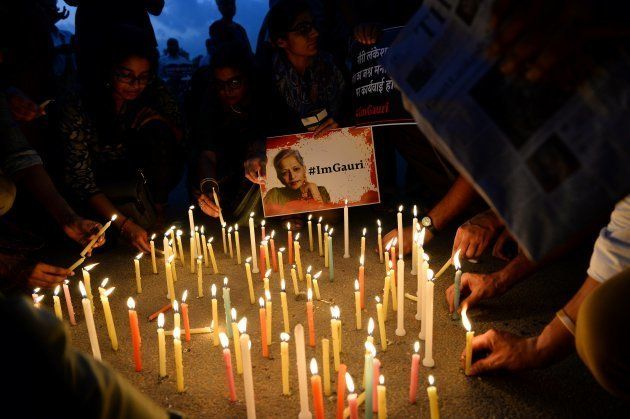 Indian activists take part in a protest rally against the killing of Indian journalist Gauri Lankesh...