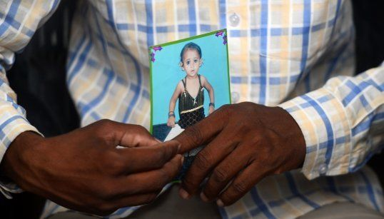 Mohammad Zahid holds his daughter's photograph in Gorakhpur on 14 August,
