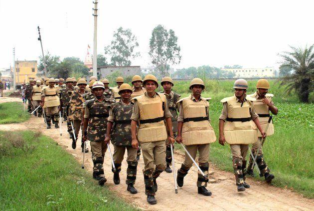 Police in Bisada village at Dadri after accused Ravi dies in Delhi hospital, on October 5, 2016 in Greater Noida, India.