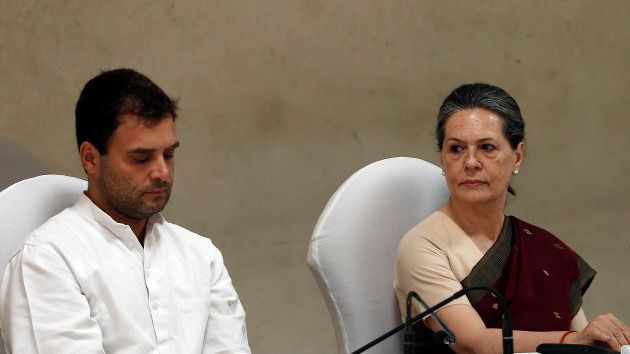 Congress party chief Sonia Gandhi (R) and her son and vice-president of Congress Rahul Gandhi attend...
