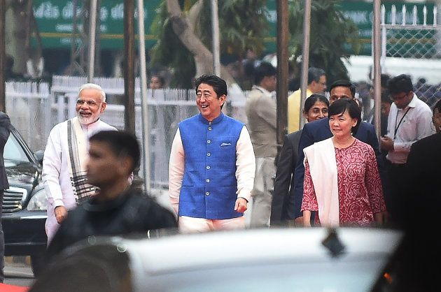 Indian Prime Minister Narendra Modi (L) arrives with Japanese Prime Minister Shinzo Abe (C) and his wife...