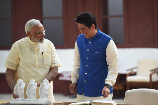 Japanese Prime Minister Shinzo Abe (C) and Indian Prime Minister Narendra Modi visit Sabarmati Ashram,...
