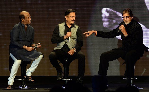 Bollywood film actor Amitabh Bachchan (R) speaks as actors Kamal Haasan (C) and Rajinikanth look on during...