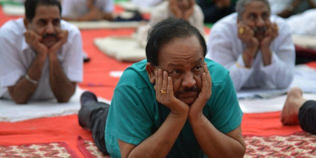 Harsh Vardhan, Indian Union Minister for Environment, Science and Technology, takes part in a yoga session...