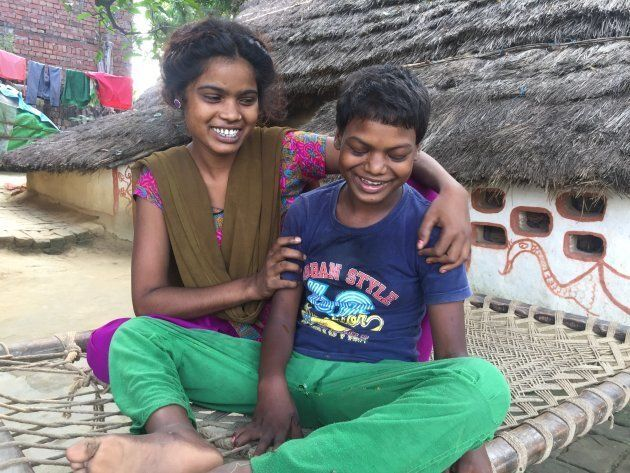 Rimin with her sister, Romal, at their village in