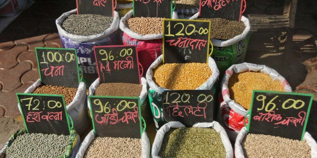 Price tags are seen on the bags of pulses that are kept on display for sale outside a shop at a market...