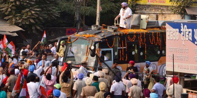 Punjab Chief Minister Capt. Amarinder Singh waves during a road show in favour of Congress candidate...