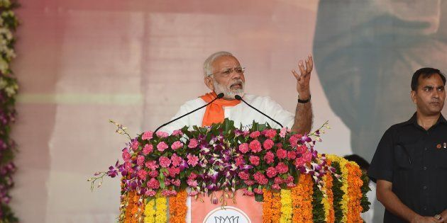 Indian Prime Minister Narendra Modi (L) addresses a gathering of Bhartiya Janta Party (BJP) supporters...