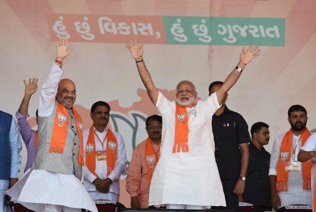 Indian Prime Minister Narendra Modi (C/R) and Bhartiya Janta Party (BJP) President Amitbhai Shah (2nd...