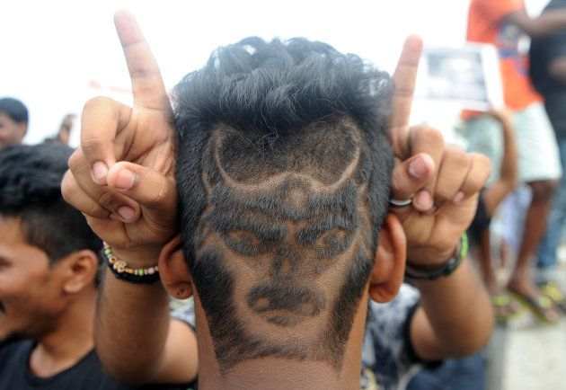 A man with his hair shaved in the shape of a bull poses during a demonstration against the ban on the...