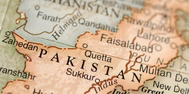 A close-up/macro photograph of Pakistan from a desktop globe. Adobe RGB color profile.