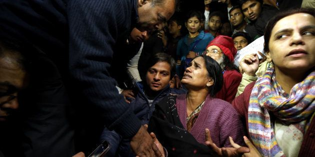 Father of Nirbhaya consoles her mother as she broke down during protest against the release of juvenile...