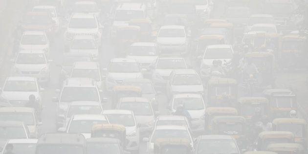 Vehicles drive through heavy smog in Delhi, India, November 8, 2017.