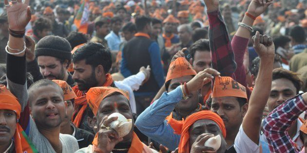 FILE PHOTO: People gather at an election campaign rally at Barabanki on February 16, 2017 near Lucknow,