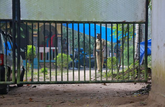 Police officers guard inside the premises of K M Ashokan, father of 24-year-old Akhila, who converted to Islam in 2016 and took a new name, Hadiya, at Vaikom in the Kottayam district.