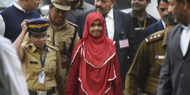 24-year-old Hadiya alias Akhila (In Red Dress) at the supreme court after hearing on November 27, 2017...
